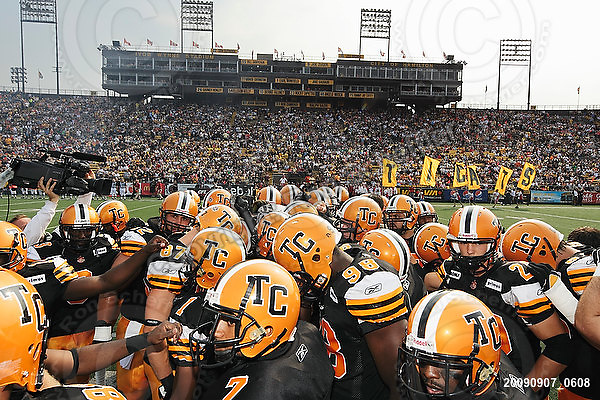 September 7, 2009; Hamilton, ON, CAN; Hamilton Tiger-Cats huddle at centrefield. CFL football - the Labour Day Classic - Toronto Argonauts vs. Hamilton Tiger-Cats at Ivor Wynne Stadium. The Tiger-Cats defeated the Argos 34-15. Mandatory Credit: Ron Scheffler.