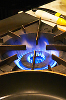 Blue gas fire flames burner on a cast iron professional restaurant kitchen stove The Dolly Irigoyen - famous chef and TV presenter - private restaurant, Buenos Aires Argentina, South America Espacio Dolli