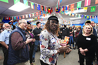 NWA Democrat-Gazette/J.T. WAMPLER Marie South from Guinea sings Wednesday Dec. 4, 2019 at the Ozark Literacy Council's holiday party. The organization has 400 adult students from 50 countries.