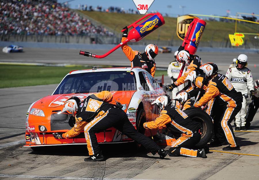Oct. 4, 2009; Kansas City, KS, USA; NASCAR Sprint Cup Series driver Joey Logano pits during the Price Chopper 400 at Kansas Speedway. Mandatory Credit: Mark J. Rebilas-