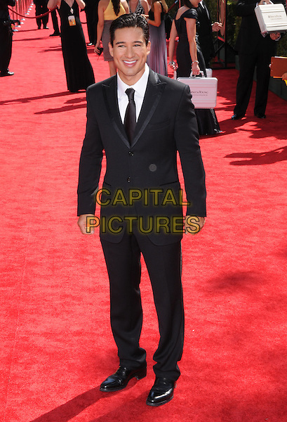 MARIO LOPEZ.Arrivals at the 61st Primetime Emmy Awards held at Te Nokia Theater in Los Angeles, California, USA..September 20st, 2009     .emmys full length black suit.CAP/DVS.©Debbie VanStory/Capital Pictures.