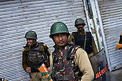 Soldiers from the paramilitary force, Central Reserve Police Force (CRPF) and Jammu & Kashmir Police are seen patrolling the streets on empty streets in the downtown area of Nowhatta, Srinagar, summer capital of Jammu and Kashmir, India. A 50 hour curfew was imposed on May 5th to boycott the elections on May 7, 2009. ..Kashmir went into polls on the 4th round of Indian general elections. About 26 percent polling was recorded in the Indian parliamentary elections held in Kashmir on Thursday, May 7th 2009. The poll percentage was on the higher side this year as compared to 2004 polls when 15.04 percent polling was recorded.