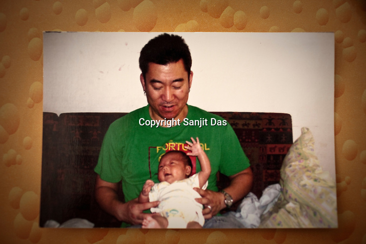 File photograph of Thomas Kim with his son Brady who the first baby to a western couple delivered on February 2nd 2007 at the Akanksha Infertility Centre & IVF Centre in Anand, Gujarat, India.