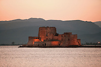 NAFPLION, GREECE - APRIL 13 : A general view of Bourtzi Castle, on April 13 2007, in Nafplion, Greece. Bourtzi Castle, seen here in the evening light, was completed by the Venetians in 1473 and served as a fortress during the long struggles between Greece and Turkey.  The castle later became the executioner's house from 1865 until 1930. The city of Nafplion was the first capital of modern Greece from 1829-1834. (Photo by Manuel Cohen)