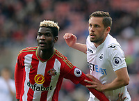 (L-R) Didier Ndong of Sunderland challenges Gylfi Sigurdsson of Swansea City during the Premier League match between Sunderland and Swansea City at the Stadium of Light, Sunderland, England, UK. Saturday 13 May 2017