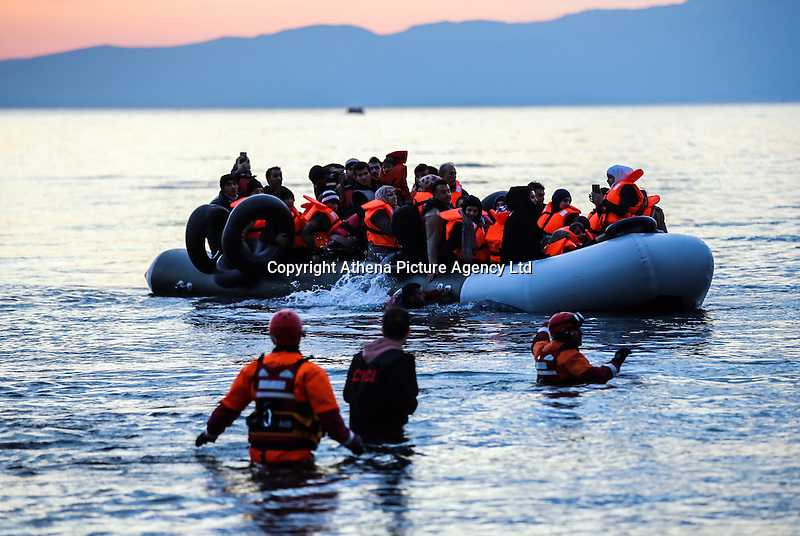 Pictured: An inflatable boat lands in Lesvos Wednesday 09 March 2016<br /> Re: Migrants have been landing on beaches near the area of the airport at the area of Mytilene in Lesvos island, Greece
