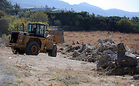 Pictured: Diggers work to clear the new site of the search, where rubble was deposited from the farmhouse where Ben Needham disappeared from in Kos, Greece. Thursday 06 October 2016<br />