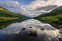 The sky reflects brilliantly on Lower Summit Lake along the Seward Highway in Alaska's Chugach National Forest.