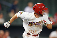 Memphis Redbirds shortstop Paul DeJong (11) runs to first base during a game against the Round Rock Express on April 28, 2017 at AutoZone Park in Memphis, Tennessee.  Memphis defeated Round Rock 9-1.  (Mike Janes/Four Seam Images)