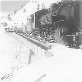 D&amp;RGW #495 with eastbound work extra crossing Cascade Creek Trestle west of Osier.<br /> D&amp;RGW  Osier, CO  Taken by Norwood, John B. - 1/1952