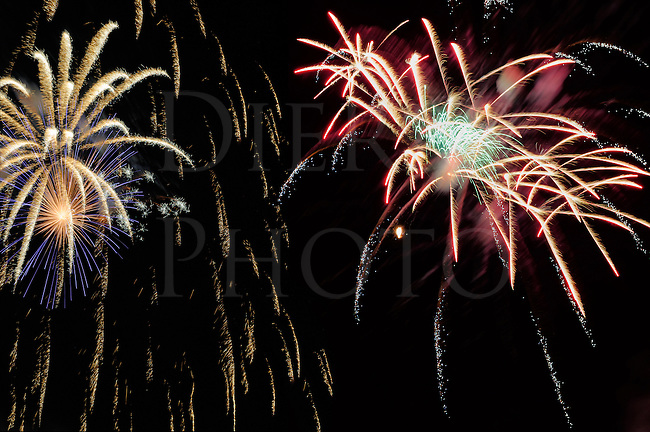 Fireworks white burst explosion against the night sky in holiday celebration, design elements and backgrounds.