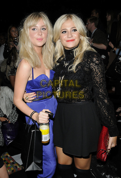DIANA VICKERS & PIXIE LOTT.The Ashish s/s 2011 fashion show, London Fashion Week, Day 5, London, England..September 21st, 2010.LFW half 3/4 length black skirt top dress lace sleeves long blue jumpsuit.CAP/CAN.©Can Nguyen/Capital Pictures.
