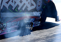 Feb 12, 2016; Pomona, CA, USA; Detailed view of the header exhaust pipes on the engine of NHRA funny car driver Courtney Force during qualifying for the Winternationals at Auto Club Raceway at Pomona. Mandatory Credit: Mark J. Rebilas-USA TODAY Sports