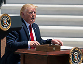 July 15, 2019 - Washington, DC, United States: United States President Donald J. Trump prepares to sign an Executive Order on Maximizing Use of American-Made Goods, Products, and Materials during the 3rd Annual Made in America Product Showcase at the White House. <br /> Credit: Chris Kleponis / Pool via CNP
