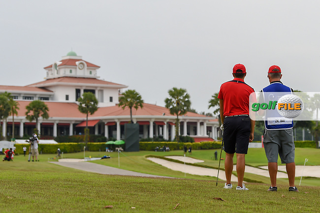 Zheng Kai BAI (CHN) looks over his approach shot on 18 during Rd 3 of the Asia-Pacific Amateur Championship, Sentosa Golf Club, Singapore. 10/6/2018.<br /> Picture: Golffile | Ken Murray<br /> <br /> <br /> All photo usage must carry mandatory copyright credit (© Golffile | Ken Murray)