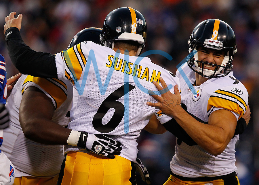 ORCHARD PARK, NY - NOVEMBER 28:  Daniel Sepulveda #9 celebrates with teammate Shaun Suisham #6 of the Pittsburgh Steelers after kicking the game winning field goal in overtime against the Buffalo Bills during the game on November 28, 2010 at Ralph Wilson Stadium in Orchard Park, New York.  (Photo by Jared Wickerham/Getty Images)