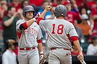 Houston Cougars designated hitter Jacob Lueneburg #42 greets teammate Casey Grayson #18 at the plate during the NCAA baseball game against the Texas Longhorns on March 1, 2014 during the Houston College Classic at Minute Maid Park in Houston, Texas. The Longhorns defeated the Cougars 3-2. (Andrew Woolley/Four Seam Images)