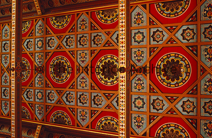 A detail of the 19th century neo-gothic red and gold hand-painted wooden panels by Eugene Viollet-le-Duc