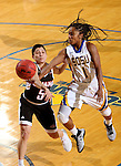 BROOKINGS, SD - JANUARY 7:  Alexis Alexander #1 from South Dakota State is fouled while taking the ball to the basket by Amber Vidal #5 from the University of Nebraska Omaha during their game Saturday afternoon at Frost Arena in Brookings. (Dave Eggen/Inertia)