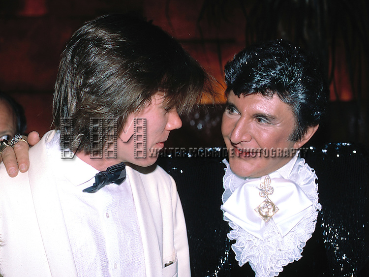 Liberace and boyfriend Carey James with Kevin Bacon attending the after party held at the Trump Tower celebrating his opening night performance at Radio City Music Hall..April 1985...