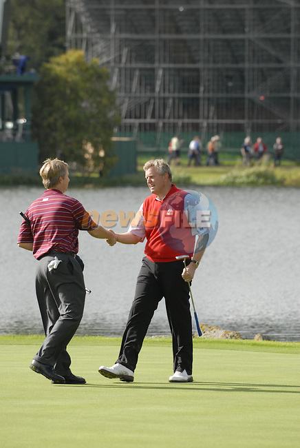 European Team player Colin Montgomerie shakes opponent David Toms hand after beating him on the 17th green during the final day singles matches of the 2006 Ryder Cup at The K Club Saturday 24th September 2006.(Photo Eoin Clarke/Newsfile)