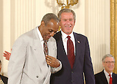 Washington, DC - July 9, 2002 -- United States President George W. Bush honors Bill Cosby with the Presidential Medal of Freedom during a ceremony in the East Room of the White House in Washington, D.C. on July 9, 2002..Credit: Ron Sachs / CNP