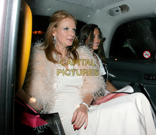 "OLIVIA INGE & PIPPA MIDDLETON.Leaving The ""End of Summer Ball"" at Berkeley Square, London, England. .September 25th 2008.half length white pink fur wrap feather dress car cab taxi sitting .CAP/AH.©Adam Houghton/Capital Pictures."
