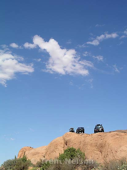 Off-road enthusiasts put their rubber on the slickrock at the beginning of Moab's Hell's Revenge 4x4 trail. The trail is ranked very difficult, a 4+ on a 1-4 scale.<br />