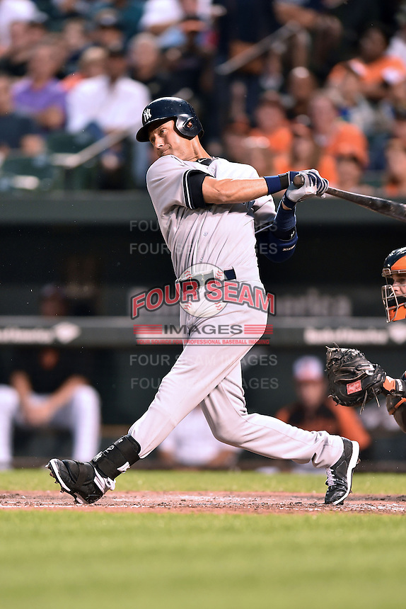 New York Yankees shortstop Derek Jeter #2 swings at a pitch during a game against the Baltimore Orioles at Oriole Park at Camden Yards August 11, 2014 in Baltimore, Maryland. The Orioles defeated the Yankees 11-3. (Tony Farlow/Four Seam Images)
