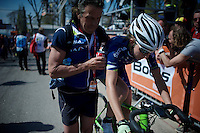 helping a rider after finishing the 2015 Flèche Wallonne Féminine