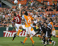 Troy Perkins #23 of D.C. United goes up for a cross with Brian Ching #25 of the Houston Dynamo during an MLS match at RFK Stadium in Washington D.C. on September  25 2010. Houston won 3-1.