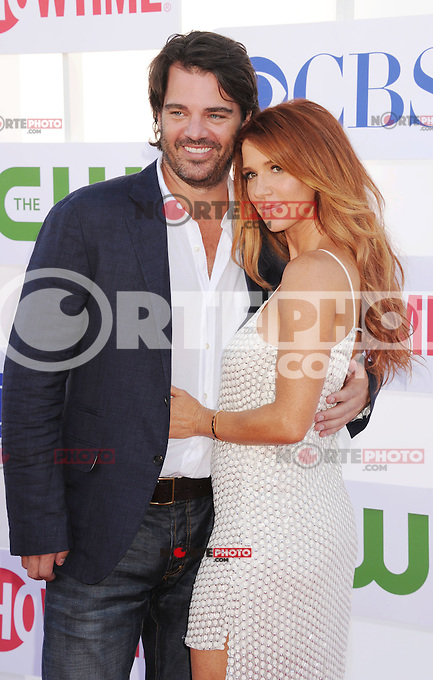 BEVERLY HILLS, CA - JULY 29: Adam Kaufman and Poppy Montgomery arrive at the CBS, Showtime and The CW 2012 TCA summer tour party at 9900 Wilshire Blvd on July 29, 2012 in Beverly Hills, California. /NortePhoto.com<br /> <br />  **CREDITO*OBLIGATORIO** *No*Venta*A*Terceros*<br /> *No*Sale*So*third* ***No*Se*Permite*Hacer Archivo***No*Sale*So*third*