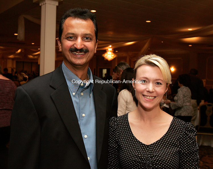 WATERBURY, CT, -07  OCTOBER 2010-100710JS12-Vipul (Victor) Shah, Proprietor of Mountain Top Liquor in Waterbury and Lisa Rubbo of Modern Pastry Shop in Hartford, at the In Good Taste, A Tasting event at the Ponte Club in Waterbury. Proceeds from the event will benefit the Morris Foundation Women and Children's Program. <br /> Jim Shannon Republican-American