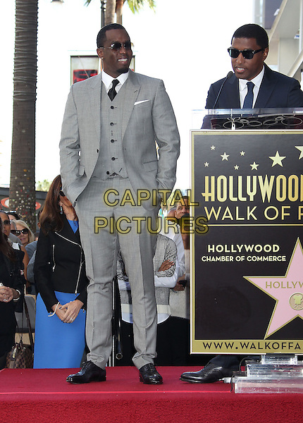 Sean 'P. Diddy' Combs, Kenny 'Babyface' Edmonds<br /> Musician, songwriter and producer Kenny 'Babyface' Edmonds is Honored On The Hollywood Walk Of Fame, Hollywood, CA, USA, <br /> 10th October 2013.<br /> full length speaking sunglasses grey gray suit microphone goatee facial hair beard hands in pockets puffy puff daddy diddy <br /> CAP/ADM/RE<br /> &copy;Russ Elliot/AdMedia/Capital Pictures
