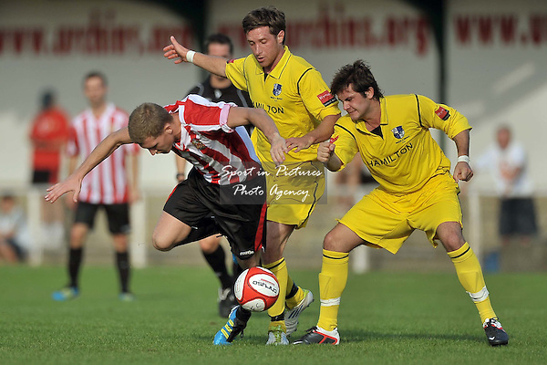 Lewis Smith (Hornchurch) tries to squeeze between Ross Parmenter (Wingate, centre) and Joe O'Brien (Wingate, right). AFC Hornchurch Vs Wingate and Finchley. Ryman Premier League. The Stadium. Essex. 01/10/2011. MANDATORY Credit Sportinpictures/Garry Bowden - NO UNAUTHORISED USE - 07837 394578.