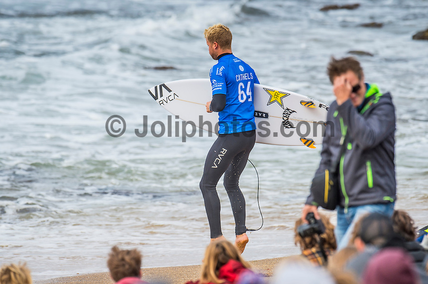 BELLS BEACH, Victoria/AUS (Monday, March 28, 2016)Davey Cathels (AUS)  - Action at the Rip Curl Pro Bells Beach, the second stop on the World Surf League (WSL) Championship Tour (CT), continued today with the remaining six heats of Round Three before the contest was called off for the day.<br /> There were onshore South West winds throughout the day with a dropping swell in the 3'-5' range. <br /> The Heritage Round with Damien Hardman (AUS) and Barton Lynch (AUS) was held today with Lynch coming out victorious. <br /> <br /> Bells Beach has been hosting surfing tournaments for more than 50 years now, making it the most renowned spot on the raw and rugged southern coast of Victoria, Australia. The list of  Rip Curl Pro event champions is a veritable who's who of surfing icons, including many world champions.<br /> <br /> Surfing's greats have a way of dominating Bells. Mark Richards, Kelly Slater, and Mick Fanning all have four Bells trophies; Michael Peterson and Sunny Garcia, three; While Simon Anderson, Tom Curren, Joel Parkinson, Andy Irons, and Damien Hardman each grabbed a pair.<br /> <br /> The story is similar on the women's side. Lisa Andersen and Stephanie Gilmore have four Bells titles; Layne Beachley and Pauline Menczer, three; while Kim Mearig and Sally Fitzgibbons each have two.<br /> <br /> The 2016 event is about to kick off tomorrow and there was a packed warm up session at Bells this morning. <br /> Photo: joliphotos.com