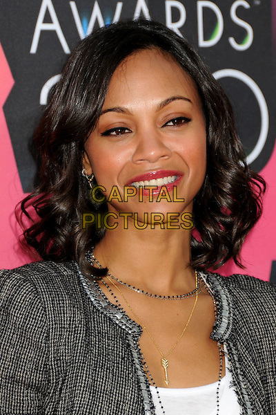 ZOE SALDANA .at the 23rd Annual Nickelodeon Kids' Choice Awards 2010 held at Pauley Pavilion in Westwood, California, USA, March 27th 2010 .arrivals kids portrait headshot bob tweed jacket grey gray blazer white top t-shirt necklaces silver gold arrow charm black and white gingham houndstooth ribbon edged edge smiling .CAP/ADM/BP.©Byron Purvis/Admedia/Capital Pictures