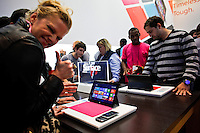 Customers looks at the new Microsoft tablet Surface during the opening of Microsoft's store at Times Square in New York, October 25, 2012. . Photo by Eduardo Munoz Alvarez / VIEW.