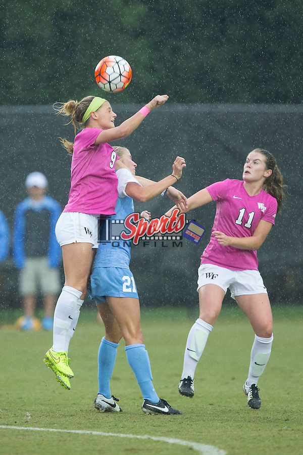 Bayley Feist (9) of the Wake Forest Demon Deacons battles for a jump ball against Cameron Castleberry (21) of the North Carolina Tar Heels during first half action at Spry Soccer Stadium on September 27, 2015 in Winston-Salem, North Carolina.  The Tar Heels defeated the Demon Deacons 1-0.  (Brian Westerholt/Sports On Film)