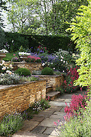 A colourful array of flowers, herbs and shrubs greet the eye when entering the garden