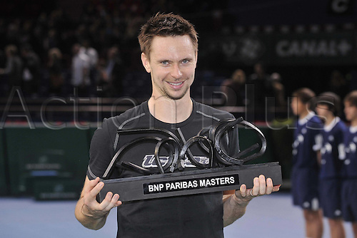 14.11.2010 ATP Master Tennis, Paris. Robin Soderling, Sweden, cheering his victory in the final match with the trophy.
