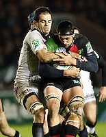 Photo: Richard Lane/Richard Lane Photography. Harlequins v Stade Toulouse. Heineken Cup. 09/12/2011. Quins' Tomas Vallejos is tackled by Toulouse's Gregory Lamboley.