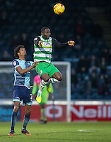 Francois Zoko of Yeovil Town rises for the ball under pressure from Sido Jombati of Wycombe Wanderers during the Sky Bet League 2 match between Wycombe Wanderers and Yeovil Town at Adams Park, High Wycombe, England on 14 January 2017. Photo by Andy Rowland / PRiME Media Images.