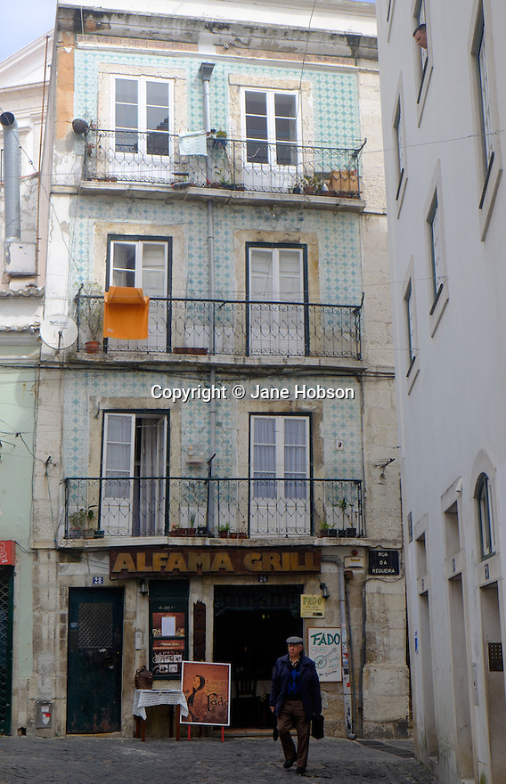 Lisbon, Portugal. 21.03.2015. Alfama Grill, in a typical narrow street in the Alfama district of Lisbon. © Jane Hobson.