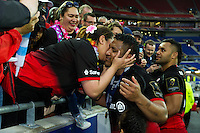 Mako Vunipola of Saracens celebrates with family after the match. European Rugby Champions Cup Final, between Saracens and Racing 92 on May 14, 2016 at the Grand Stade de Lyon in Lyon, France. Photo by: Patrick Khachfe / Onside Images