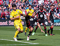 Dwayne De Rosario (7) of D.C. United tries a bicycle kick over Agustin Viana (24) of the Columbus Crew during the game at RFK Stadium in Washington, DC.  Columbus Crew defeated D.C. United, 2-1.
