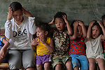 Teacher Lodema Dela Cruz Doroteo sings a song with children in a class in Santa Ines, an indigenous village in the Philippines. A graduate of Harris Memorial College, where she benefited from a scholarship from United Methodist Women, she is the first indigenous school teacher in her village.