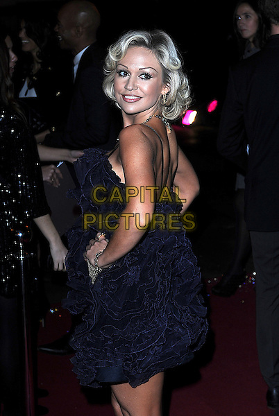KRISTINA RIHANOFF .attending The British Fashion Awards, Royal Courts of Justice, London, England, UK, 9th December 2009..arrivals half length blue gathered ruffle dress ruffles hands on hips back side over shoulder rear behind .CAP/BEL.©Tom Belcher/Capital Pictures.
