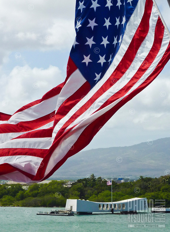 An American flag flying near the USS Arizona Memorial, Pearl Harbor, Oahu
