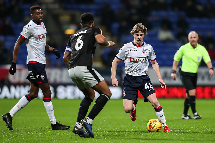 Bolton Wanderers' Luca Connell competing with Reading's Liam Moore  <br /> <br /> Photographer Andrew Kearns/CameraSport<br /> <br /> The EFL Sky Bet Championship - Bolton Wanderers v Reading - Tuesday 29th January 2019 - University of Bolton Stadium - Bolton<br /> <br /> World Copyright © 2019 CameraSport. All rights reserved. 43 Linden Ave. Countesthorpe. Leicester. England. LE8 5PG - Tel: +44 (0) 116 277 4147 - admin@camerasport.com - www.camerasport.com